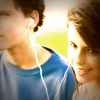 Adolescent boy and girl share headphones