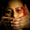 Bashed Aboriginal woman with man's hands over her mouth