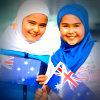 Girls in hijabs waving Australian flags