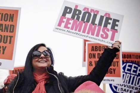 Rep from New Wave Feminists holds a placard that says she is a prolife feminist