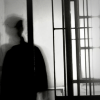 Silhouette of boy and bars