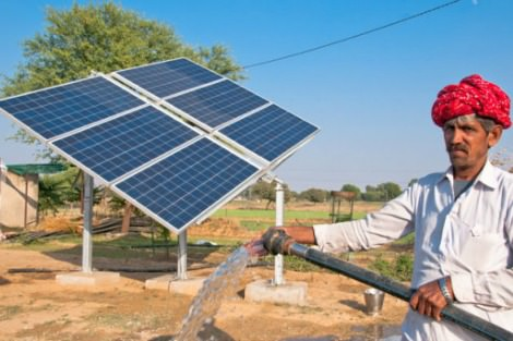 Indian man with solar panel