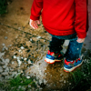Child on wet footpath