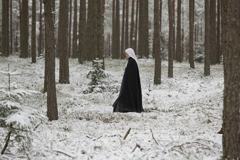Nun walks through snowy woods in The Innocents