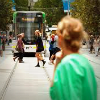 Woman watches tram