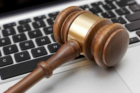 Judge's gavel on laptop keyboard