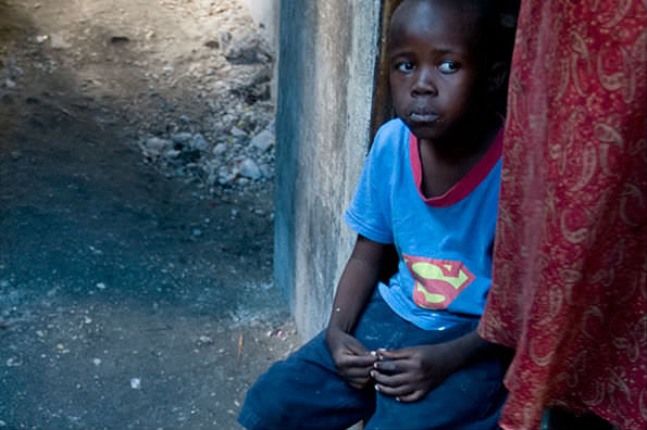 A boy sits outside his house in Cite L'Eternel, a poor neighbourhood of Port au Prince, Haiti. UN Photo/Marco Dormino