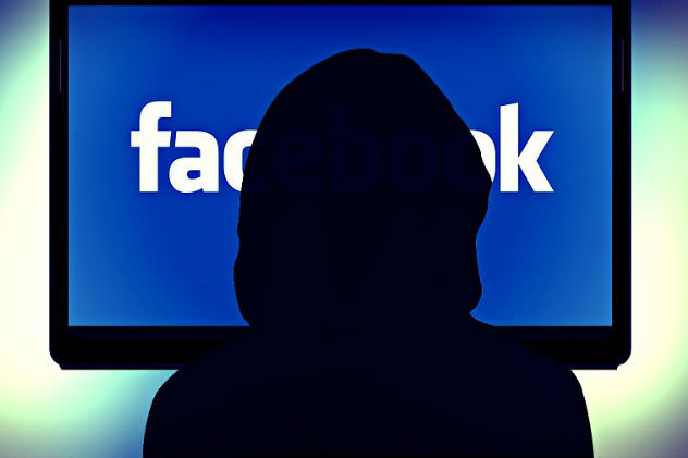 Silhouette in front of Facebook screen