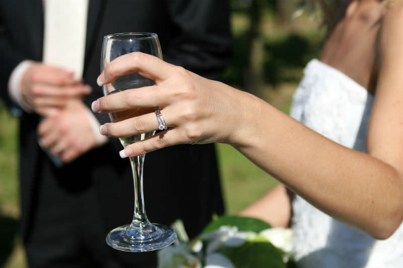 Bride's hand with champagne