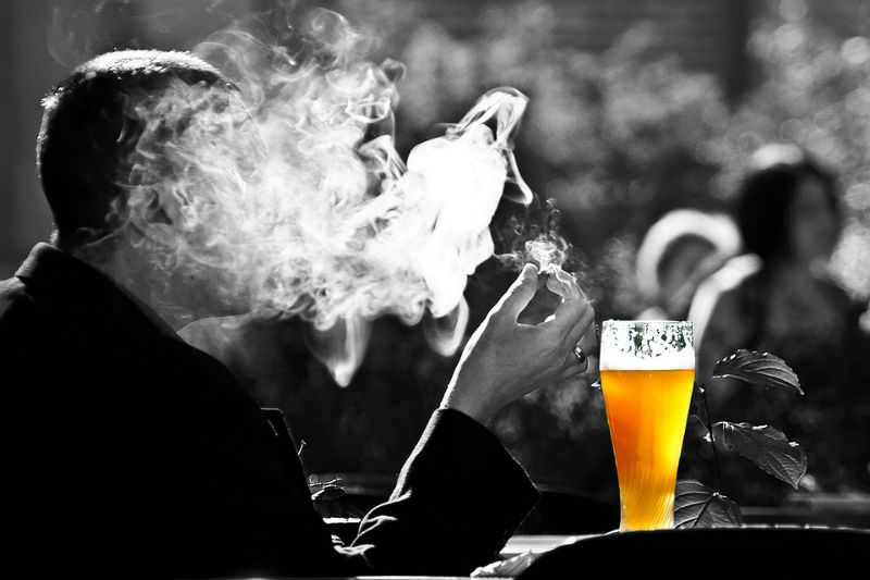 Smoking man with beer