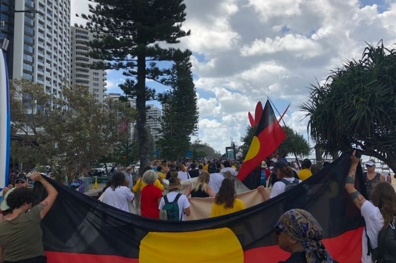 The Gold Coast Stolenwealth Games protest marches along the Surfers Paradise foreshore. Photo by Jack Latimore, IndigenousX