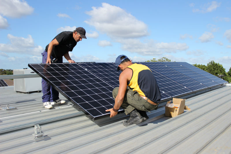 Shared solar system being installed on an apartment block at Murundaka Cohousing Community, Heidelberg Heights.