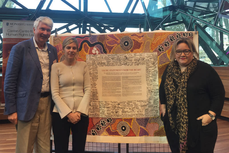 Frank Brennan with co-panellists Kristen Hilton, Victorian Equal Opportunity and Human Rights Commissioner, and Megan Davis, Member of the UN Expert Mechanism on Rights of Indigenous Peoples, in front of the Uluru Statement.