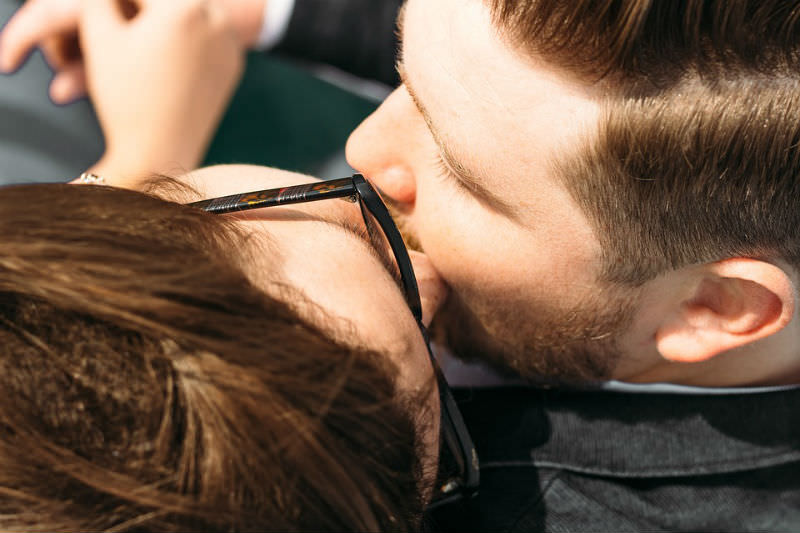 Woman kisses man