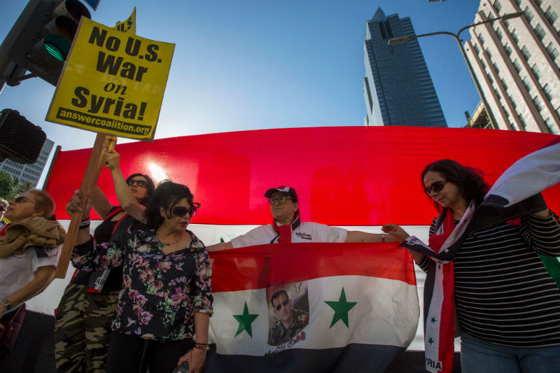Supporters of Syrian president Bashar al-Assad protest the US-led coalition attack in Syria, on 14 April 14 2018 in Los Angeles, California. (David McNew/Getty Images)