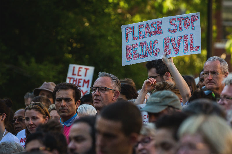 Thousands of Melbournians rallied on the steps of the state library in coordiated, Australia-wide rallies, protesting the High Court's decision on 8 February 2016 in Melbourne, Australia. Among other protestors, an emotional man holds up a sign reading 'Stop being evil'. (Photo by Chris Hopkins/Getty Images)