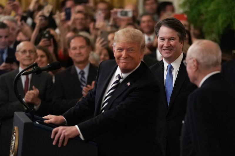 Brett Kavanaugh is sworn in as 114th Supreme Court Justice by a smiling US President Donald Trump. (Photo by Alex Wong/Getty Images)