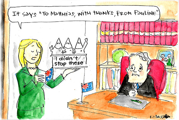 Matthias Corman receives a trophy featuring KKK members and a slogan 'I didn't stop these', along with a card saying 'Thanks, from Pauline'. Cartoon by Fiona Katauskas