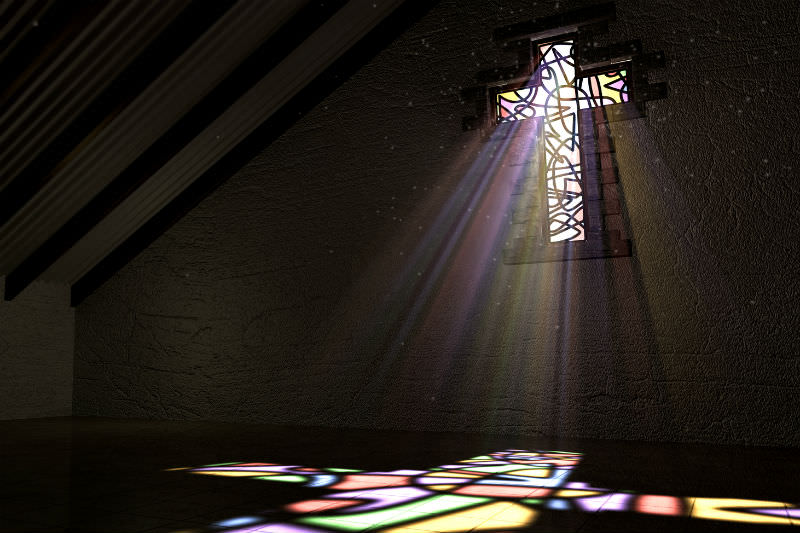 Light rays through a cross-shaped stained glass window