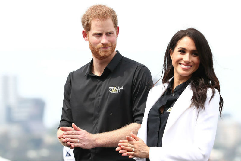 Prince Harry, Duke of Sussex and Meghan, Duchess of Sussex applaud during the medal ceremony during the JLR Drive Day at Cockatoo Island on 20 October 2018. (Mark Metcalfe/Getty Images for the Invictus Games Foundation)