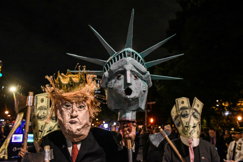 A person wears a Donald Trump themed costume in the annual Village Halloween parade on Sixth Avenue, New York (Stephanie Keith/Getty Images)