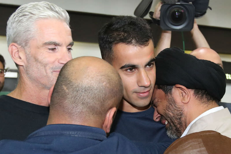 Hakeem al-Araibi is embraced by supporters as Craig Foster, former Australian football captain and commentator, looks on as he arrives at Melbourne Airport. Photo by Scott Barbour/Getty Images