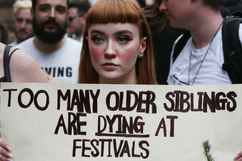A young pill testing supporter holds a sign during a rally outside Sydney Town Hall on 19 January 2019 in Sydney, calling on the government to support pill testing at music festivals and raves. (Photo by Lisa Maree Williams/Getty Images)