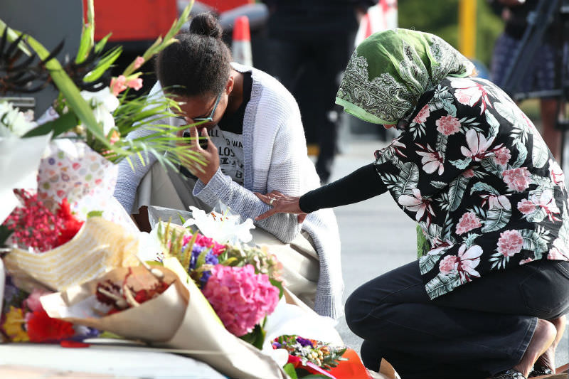 Locals lay flowers in tribute to those killed and injured in the Christchurch attack. Photo by Fiona Goodall/Getty Images