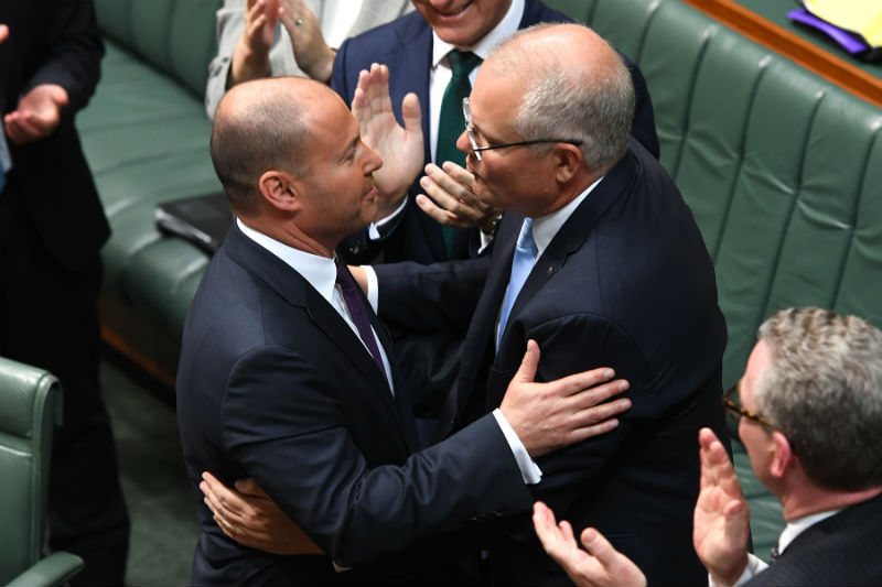 Treasurer Josh Frydenberg is congratulated by Prime Minister Scott Morrison after delivering the budget in the House of Representatives. (Photo by Tracey Nearmy/Getty Images)