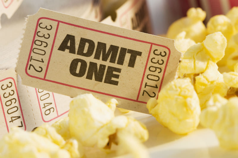 Admit One ticket with scattered popcorn