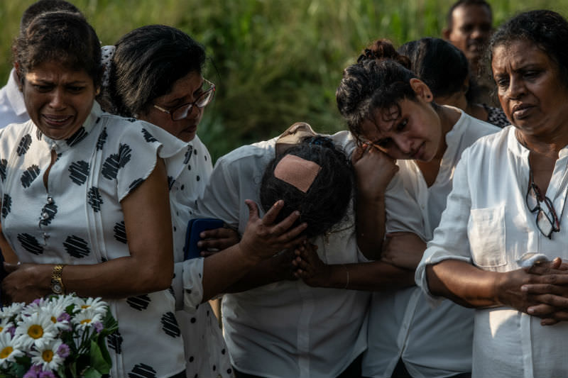 Women weep as another is overcome with emotion during the funeral of a person killed in the Easter Sunday attack on St Sebastian's Church, on 23 April 2019 in Negombo, Sri Lanka. Photo by Carl Court/Getty Images