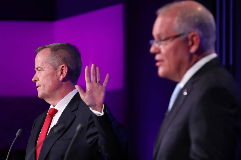Labor leader Bill Shorten raises a dismissive hand as Prime Minister Scott Morrison makes a point during the Leaders' Debate at the National Press Club on 8 May 2019. (Photo by Liam Kidston/News Corp Australia via Getty Images)