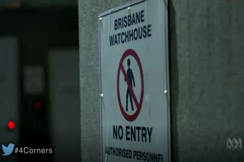 Still from Four Corners report shows sign that says Brisbane Watch House: No Entry, Authorised Personnel