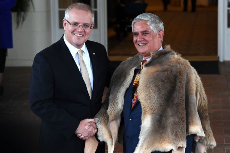 Prime Minister Scott Morrison shakes hands with Minister for Indigenous Australians Ken Wyatt at Government House in Canberra on 29 May 2019. (Photo by Tracey Nearmy/Getty Images)
