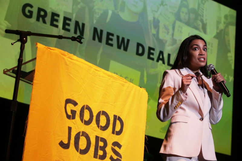 US Representative Alexandria Ocasio-Cortez promotes speaks at a rally at Howard University in Washington, DC as part of the 'Road to a Green New Deal'. (Photo by Alex Wong/Getty Images)