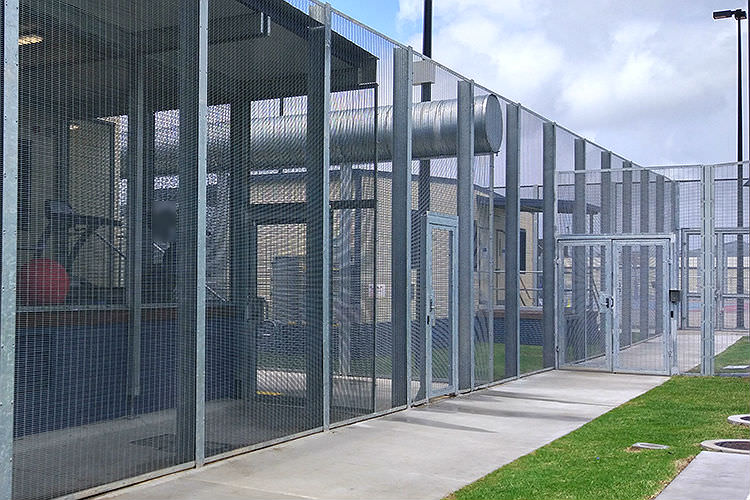 Fences and locked gates of detention centre