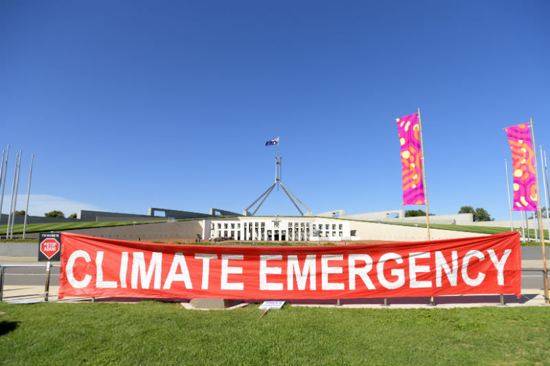 Protestors at an Anti Adani protest in front of Parliament House on 12 February 2019. (Photo by Tracey Nearmy/Getty Images)
