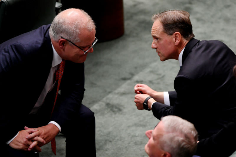 Prime Minister Scott Morrison speaks to Health Minister Greg Hunt during Question Time in Canberra on 4 April 2019. (Photo by Tracey Nearmy/Getty Images)