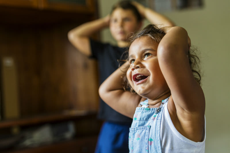 Happy Young Australian Aboriginal girl learning to sing and dance. Stock photo / Getty