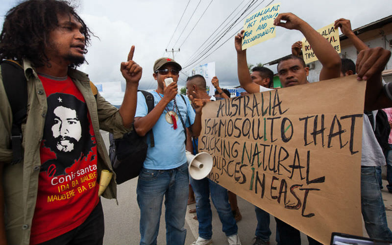 Protesters hold up signs during Anti-Australia protests on December 6, 2013 in Dili, Timor-Leste.