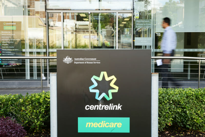A man walks into a Medicare and Centrelink office at Bondi Junction on 21 March 2016 in Sydney. (Photo by Matt King/Getty Images)