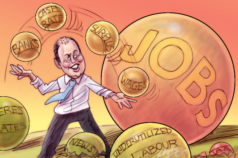 In this Chris Johnston cartoon, Treasurer Josh Frydenberg juggles balls labelled 'banks' and 'surplus' while ignoring larger balls labelled 'Newstart' and 'jobs'.