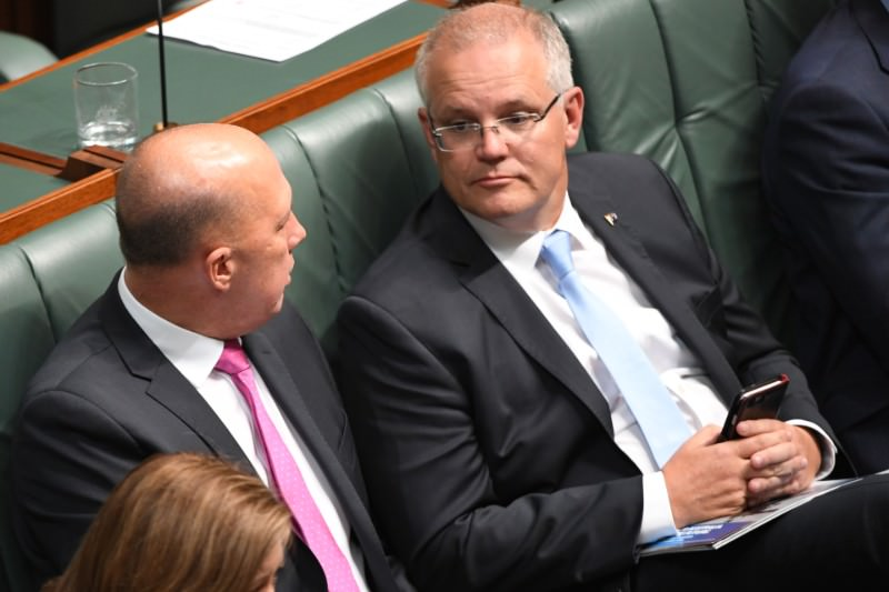 Prime Minister Scott Morrison (right) sits next to Home Affairs minister Peter Dutton as they lose a vote during divisions for the Medevac Bill in the House of Representatives in February 2019. (Photo by Tracey Nearmy/Getty Images)
