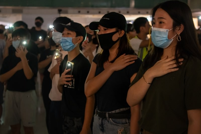 Pro-democracy protesters sing a protest anthem during a rally at a shopping mall in Shatin district of Hong Kong on 12 October 2019. (Photo by Billy H. C. Kwok/Getty Images)