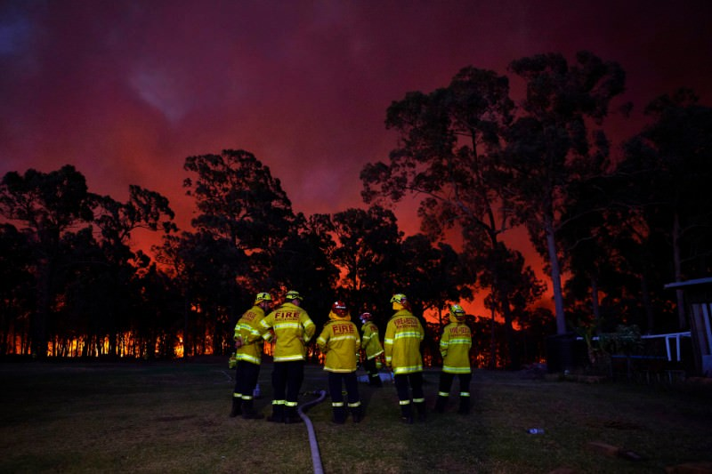 Fire crews wait at a property in in Colo Heights, NSW, as the fire front approaches on 15 November 2019. (Photo by Brett Hemmings/Getty Images)