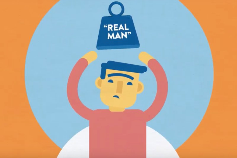 Cartoon of a man with a weight labeled 'real man' dropping towards his head. Artwork from the Men's Project.