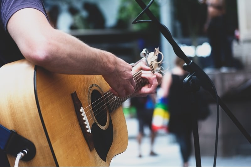 Cropped image of man performing with acoustic guitar on street ( Abhijit Patil / EyeEm)