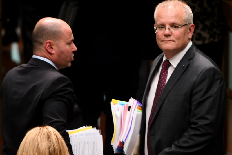 Treasurer Josh Frydenberg and Prime Minister Scott Morrison attend Question Time in December 2019, during the height the push to repeal the medevac bill. (Photo by Tracey Nearmy/Getty Images)
