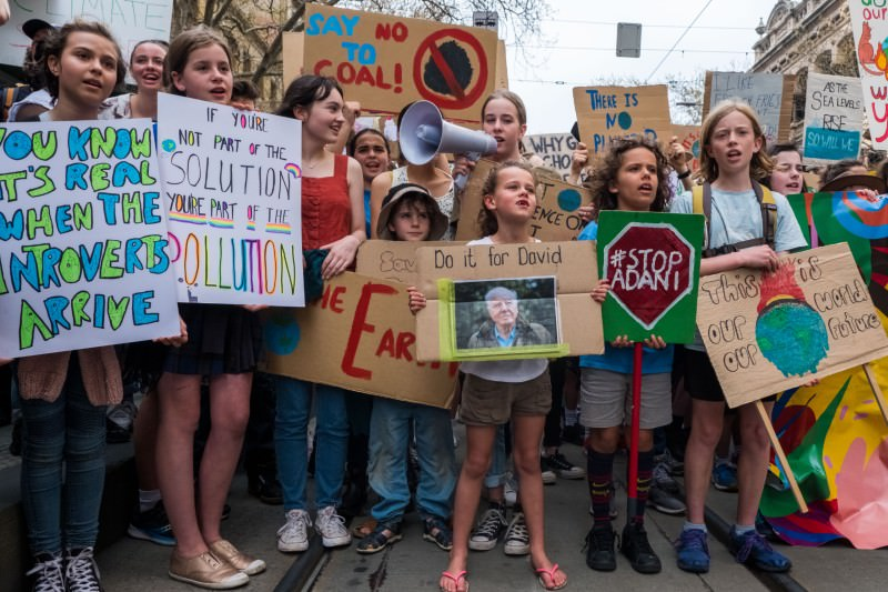 Main image: Protestors holding placards look on on 20 September 2019 at the climate strike in Melbourne. (Photo by Asanka Ratnayake/Getty Images)