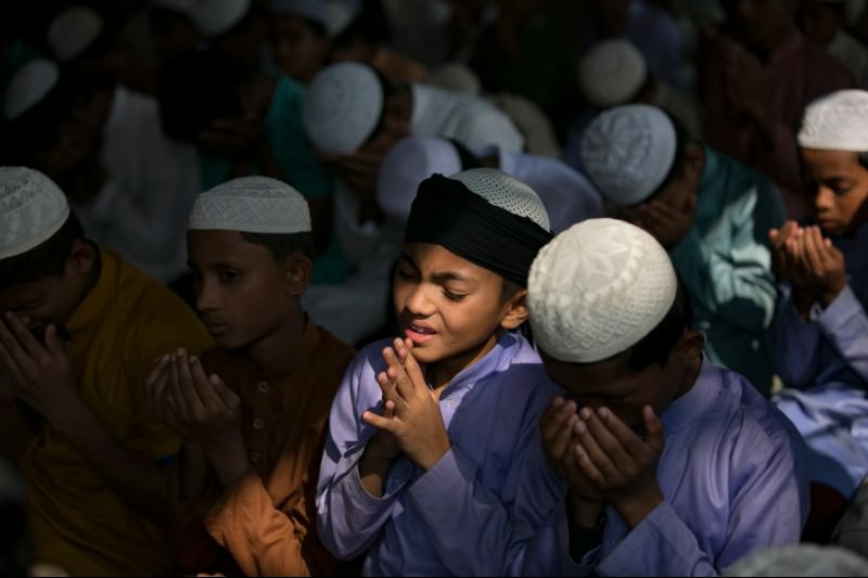 Men and boys perform a special prayer for a good outcome at the ICJ hearing at a mosque at the Cox's Bazar Rohingya refugee camp in Bangladesh on 23 January 2020. (Photo by Allison Joyce/Getty Images)